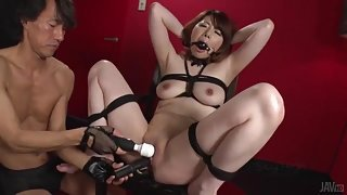 Bound and gagged Asian girl explored with toys